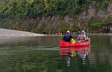 Paddling down the Whanganui River.