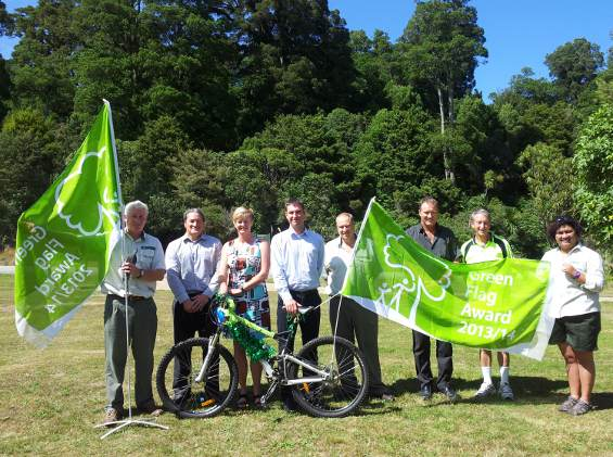 DOC staff, iwi and local council celebrate the Green Flag awards for the Pureora Timber Trail and the Waitomo Ruakuri Walk.