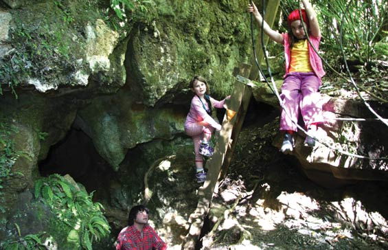 Playing in Kaniwhaniwha cave. Photo: DOC/Adrienne Grant.