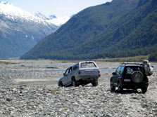 4WD drive vehicles in river bed. Photo: Ursula Paul.