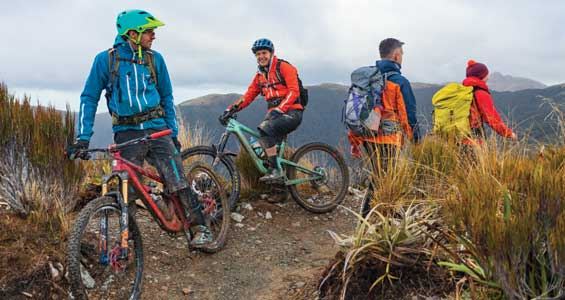 Mountain bikers give space to walkers