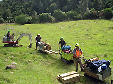 Workers taking equipment to clear the historic Waitawheta Tramway, Bay of Plenty. Warren Geraghty.
