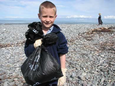 Lachlan cleaning up a beach.