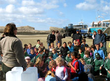 DOC Ranger Amanda Cosgrove gives Tinui and Whareama School children a briefing before they start a beach clean up at Castlepoint Scenic Reserve. Photo: S Burles.