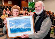 Minister of Conservation Kate Wilkinson presents a certificate to Dr Colin Burrows, 22 December 2010.