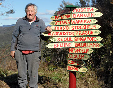 Rod Eatwell standing next to a sign.