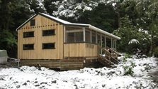 Atiwhakatu Hut offers warmth and comfort in wintry conditions. Photo: Hayden Barrett.
