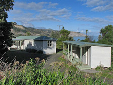 Te Kopi Cottage, in a perfect spot in Palliser Bay. Photo: Joe Hansen.