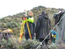 Nadine Bott setting up a theodolite at the lookout during the Cook Strait whale survey. Photo: Simon Childerhouse.