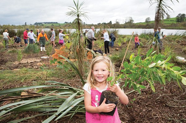 Girl with a tree at a communitiy open day. Photo: Fonterra.