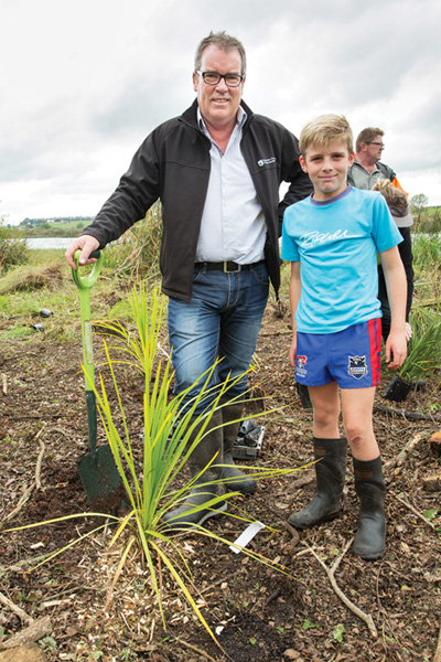 Man and boy at a community open day. Photo: Fonterra.
