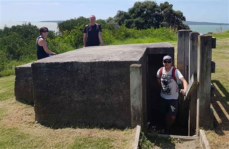 People posing at Fort Takapuna bunker.