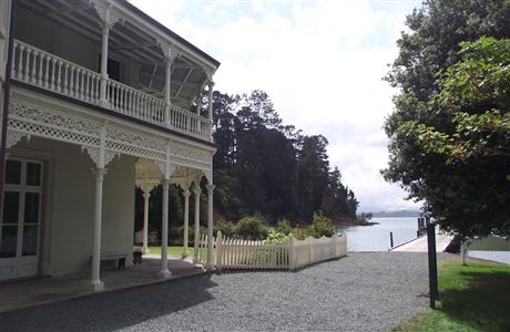 Side view of Kawau Island Mansion House and jetty.