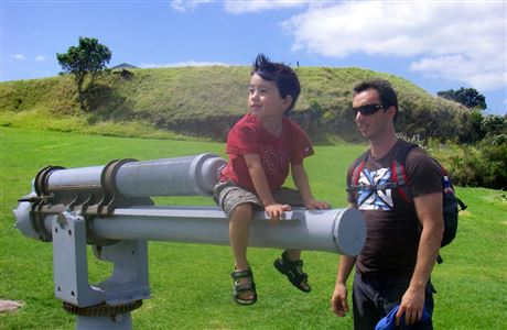 Child sitting on gun at North Head Historic Reserve.