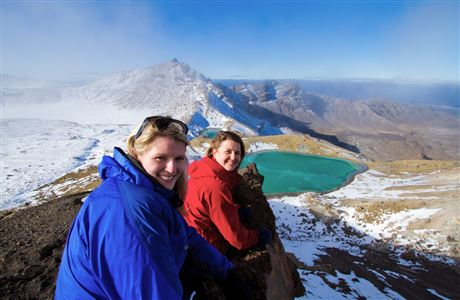 Women by emerald lake on Tongariro Northern Circuit.