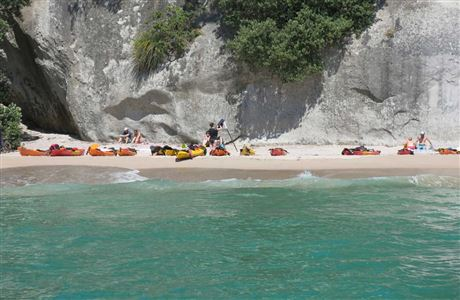 Kayakers on Cathedral Cove beach.