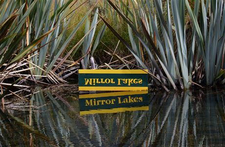 Mirror Lakes sign and reflection.