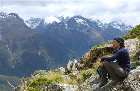 Tramper looking out at view on Routeburn Track.