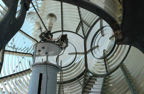 Glass and lights inside Cape Brett lighthouse.