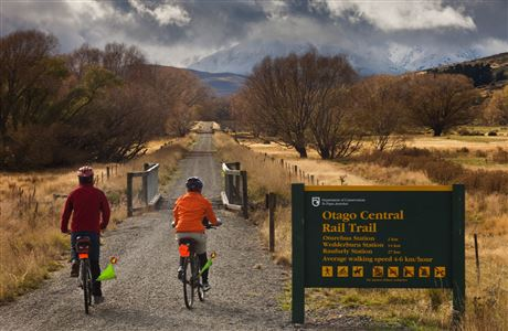 Cyclists and DOC sign, Otago Central Rail Trail.