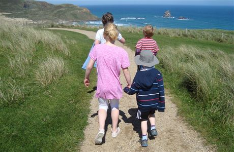 Children walking down to Sandfly Bay.